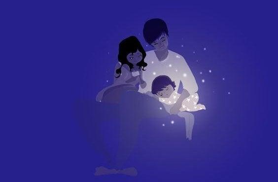 Mama i tata usypiający dziecko są partnerami
