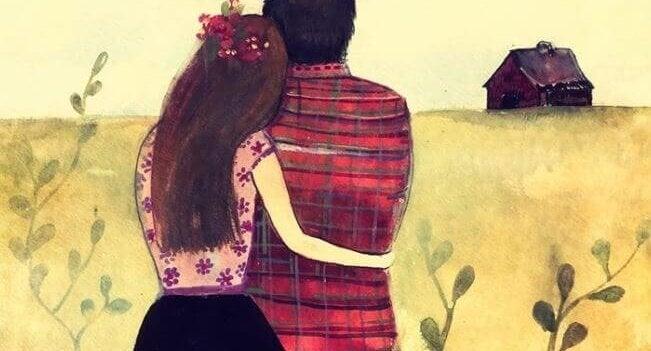 Przytulający się kobieta i mężczyzna z domem w tle