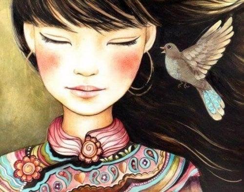 Ptak podlatuje do dziewczyny - obraz