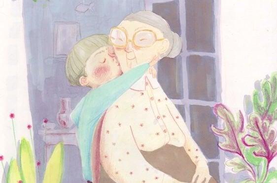 Wnuczek przytulający i całujący babcię