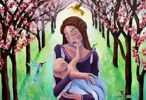 Mama trzyma w ramionach dziecko