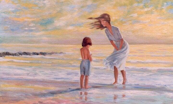 Obraz mamy nad brzegiem morza pochylającej się nad chłopcem