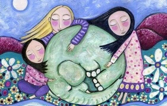 Rysunek trzech dziewczynek przytulających słonia zwiniętego w kłębek