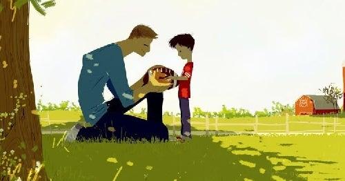 Tata gra z synem w piłkę