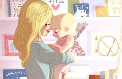 Matka trzymająca dziecko w swych ramionach